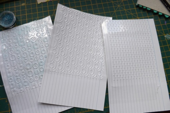 Cover big index cards with contact paper to make wipeable texture sheets. Stick 2 together or use cereal box card for a deep emboss.