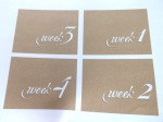 https://scrappystickyinkymess.wordpress.com/2014/04/27/white-on-kraft-week-cards-for-project-life/